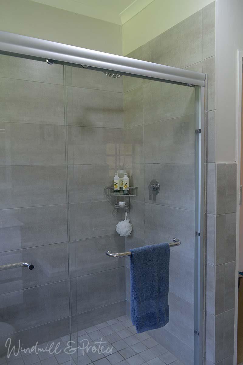 Family Bathroom Remodel Reveal - Shower Door | www.windmillprotea.com