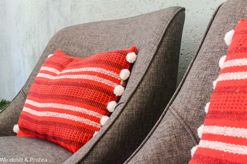 Red Scatter cushion with pom-poms | www.windmillprotea.com
